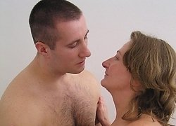 Horny old cougar enjoys having a wild fucking ride with her son's friend